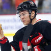 Watch: Senators Curtis Lazar Eats Hamburger Fans Threw on Ice