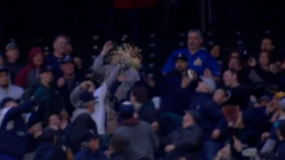 Watch: Fan at Mariners Game Uses Popcorn Bucket to Catch Foul Ball
