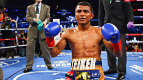 Roman Gonzalez Hangs On